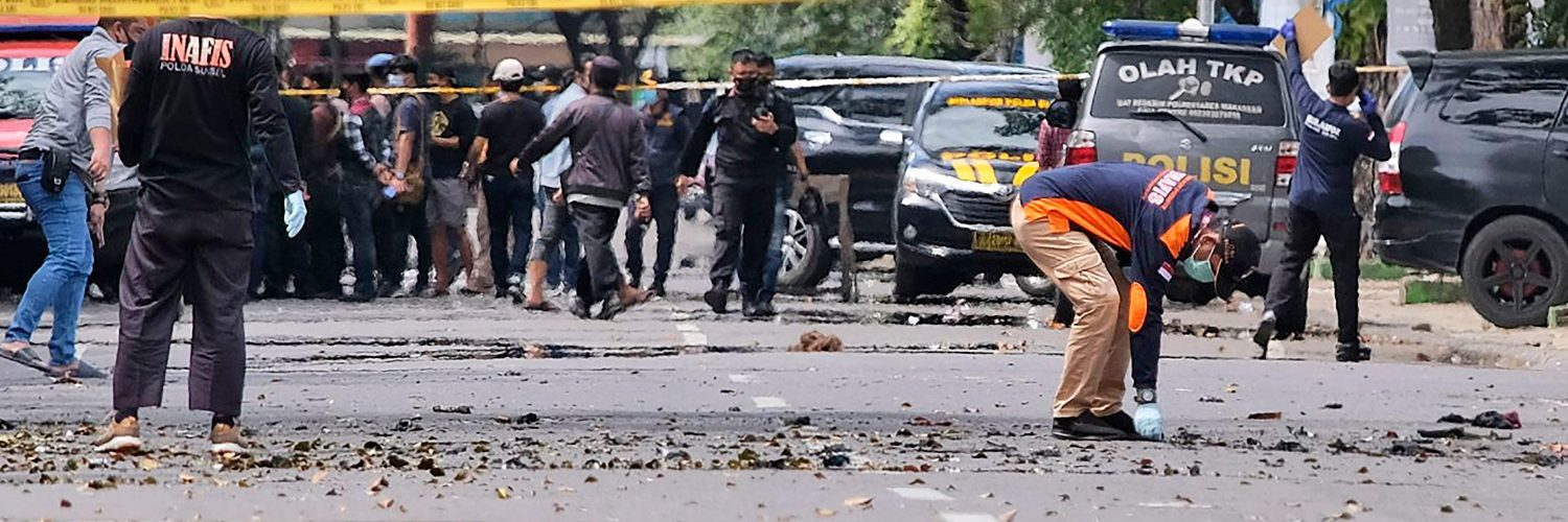 Two attackers believed to be members of a militant network that pledged allegiance to the Islamic State group blew themselves up outside a packed Roman Catholic cathedral during a Palm Sunday Mass on Indonesia's Sulawesi island, wounding at least 20 people, police said.